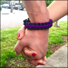Black and purple survival paracord bracelet from CauseCords. Featured in May 2015, $10 from each sale that month will go to the WSCADV